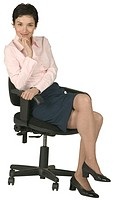 Smiling Businesswoman in an Office Chair
