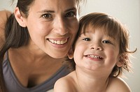 Smiling Mother and Toddler Son
