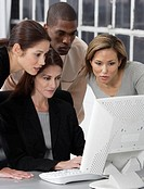 Business Team Huddling Around Computer