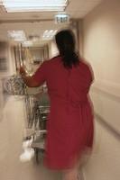 Nurse Rolling Machine in Hospital Hallway