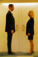 Businesspeople Standing at Doors