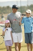 Tennis court, father, children, group picture,   Series, trainers, tennis teachers, man, 30-40 years, daughter, girls, 9 years, son, boy, 14 years, te...