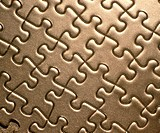 Background: gold jigsaw puzzle.
