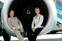 Airport, airplane, detail, engine,  Women, sitting, pose  Friends, travelers, 30-40 years, pride, cheerfully, concept, women of business, business tri...