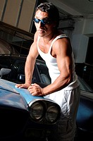 Garage, old-timers, Maserati, detail, man,  muscular, muscle shepherd, fenders,  supports Series, 20-30 years, dark-skinned, dark-haired, southern, su...