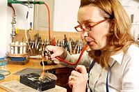 Workshop, goldsmith, solders,  Piece of jewelry, Lötbrenner,  Side portrait Occupation, craft, skilled trade, craftsmanship, goldsmith workshop, golds...