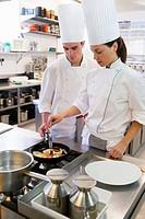 Sauteing prawns. Luis Irizar cooking school. Donostia, Gipuzkoa, Basque Country, Spain