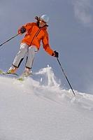 Woman, skiing, deep snow, Schneekuppe,  Jump   Sport, winters, winter sport, skier, ski, Carvingski, ski poles, winter clothing, Skikleidung, cap, gla...