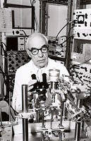 Sir John Carew Eccles 1903-1997, Australian neurophysiologist and Nobel laureate, using a microscope in a laboratory  Eccles was knighted in 1958  Ecc...