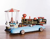 Antique toys  Tin models of a train, racing car and merry-go-round