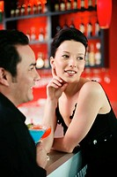 Man and woman standing at the bar counter
