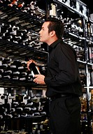 Man choosing wine in the wine cellar