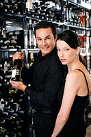 Couple choosing wine in the wine cellar