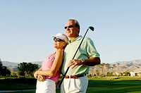 Couple posing in the golf course (thumbnail)