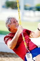 Man sitting on a swing