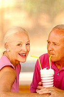Couple sharing a glass of strawberry shake (thumbnail)