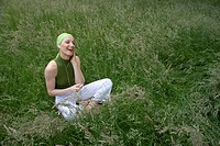 Woman, young, rehaired, meadow, sitting, Headphones, music hearing, laughing, joy, summer,  Series, 20-30 years, Top, hairband green, favorite music, ...