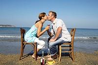 sitting beach, couple, kiss, chairs,  opposite, wine glasses,   Series, 30-40 years, partnership, relationship, love, togetherness, happily, flirt, va...