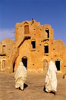 Tunisia, Ksar Ouled Soltane, inner courtyard,  Men, going, view from behind,  no models release! North Africa, South Tunisia, desert region, desert ar...