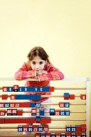 Girl posing with a large abacus
