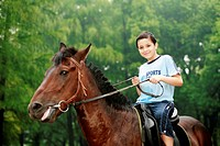 Boy riding a horse (thumbnail)