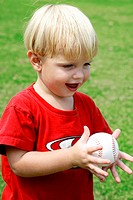 Little boy holding a baseball