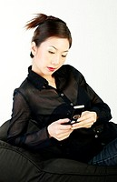 Businesswoman using the cellular phone