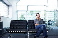 Office, leather chairs, businesswoman,  telephones, smiling,   sitting series, woman, 20-30 years, employees, chairs, bench, cell phone telecommunicat...