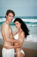 Couple posing on the beach