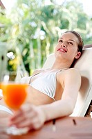 Woman relaxing on the lounge chair