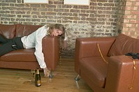 Drunken Young Reveler Collapsed on Sofa (thumbnail)