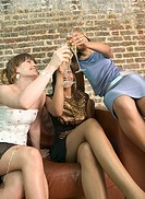 Three Women Toasting with Champagne Glasses (thumbnail)