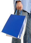 Cropped view of a man holding shopping bags.