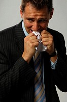 Businessman eating paper in despair