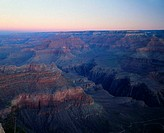 A sweeping view of the South Rim of the Grand Canyon in Grand Canyon National Park, Arizona, at sunset.