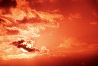 Hawaii, Sunball among clouds in dramatic red sunset sky