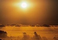 Hawaii, Sunball above clouds in dramatic sunset sky