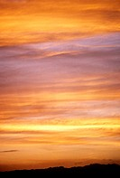 Colorful cloudy sunset sky, yellow, pink and orange