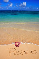 Hawaii, Turquoise ocean waters, foaming shore water, orchid lei, Peace written in sand