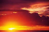 Dramatic yellow and red sunset sky as sun sinks into the ocean (thumbnail)