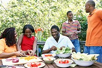 African family eating outdoors