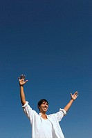 Young man, smiling, arms outstretched