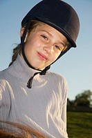 Girl wearing riding helmet