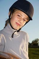 Girl wearing riding helmet