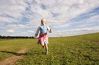 Girl running on meadow