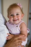 Portrait of smiling infant girl.