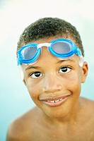 Young African boy wearing goggles on his forehead