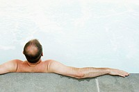 Middle-aged man relaxing in a hot tub