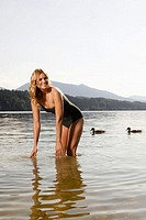 Woman standing in lake, portrait