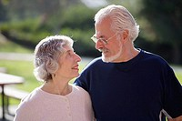 Portrait of active senior couple looking lovingly at each other in an outdoor park